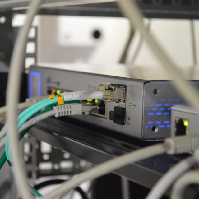 Professionally set up and managed server system with network cords and cables